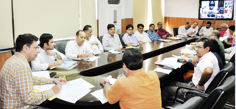 Divisional Commissioner Jammu Sanjeev Verma chairing a meeting on Tuesday.