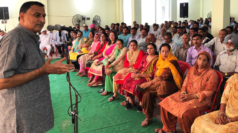 BJP leader Sham Lal Sharma addressing party workers in Akhnoor on Sunday.