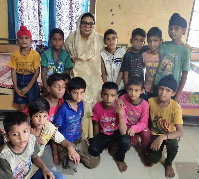 Chairperson JKSCPWCR, Vasundhara Pathak Masoodi posing for photograph with children on Thursday.