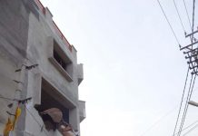 JMC using JCB to demolish a three storey building at Karan Nagar, in Jammu on Friday.
