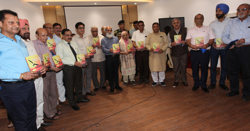 Binay Kumar Jha, Chief Commissioner of Income-Tax, Ludhiana and Amritsar, KM Bali, Principal Commissioner of Income Tax, J&K and other dignitaries releasing the book 'Parwaaz'. —Excelsior/Rakesh