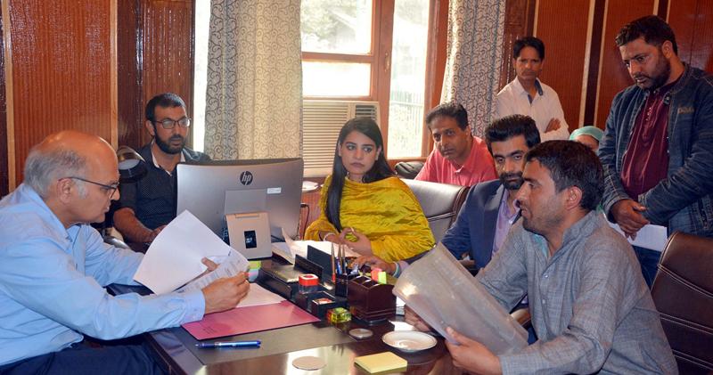 Advisor K K Sharma interacting with a delegation in Srinagar on Friday.