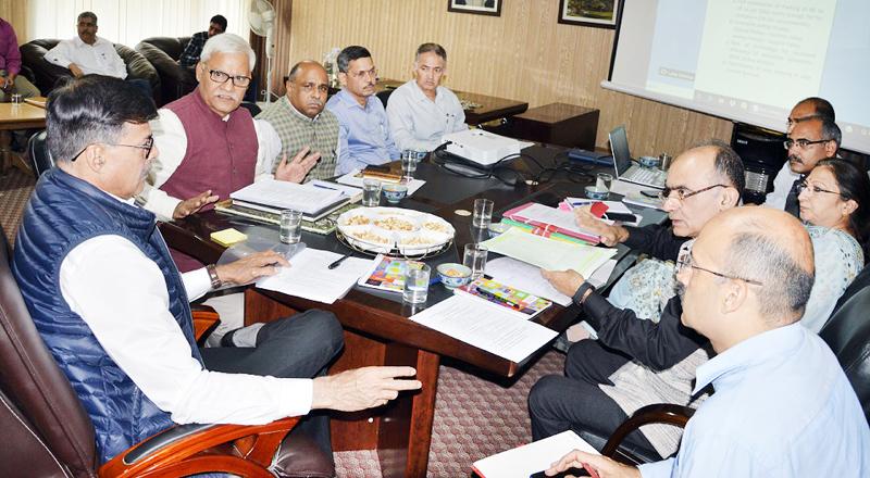 Advisor Vijay Kumar chairing a meeting on Monday.