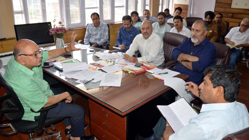 Advisor K Skandan chairing a meeting on Wednesday.