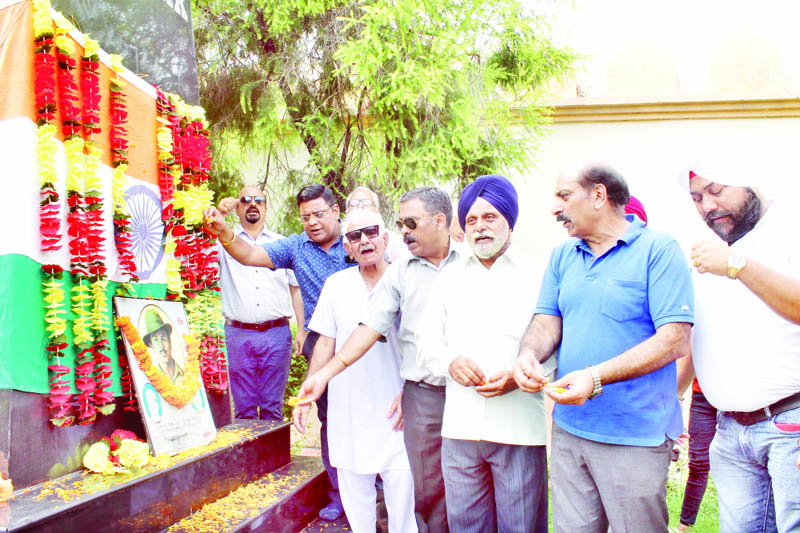 Members of JKFFA offering floral tributes to Shaheed Bhagat Singh at Jammu on Friday.