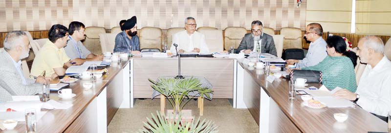 Advisor Farooq Khan chairing a meeting at Srinagar on Monday.