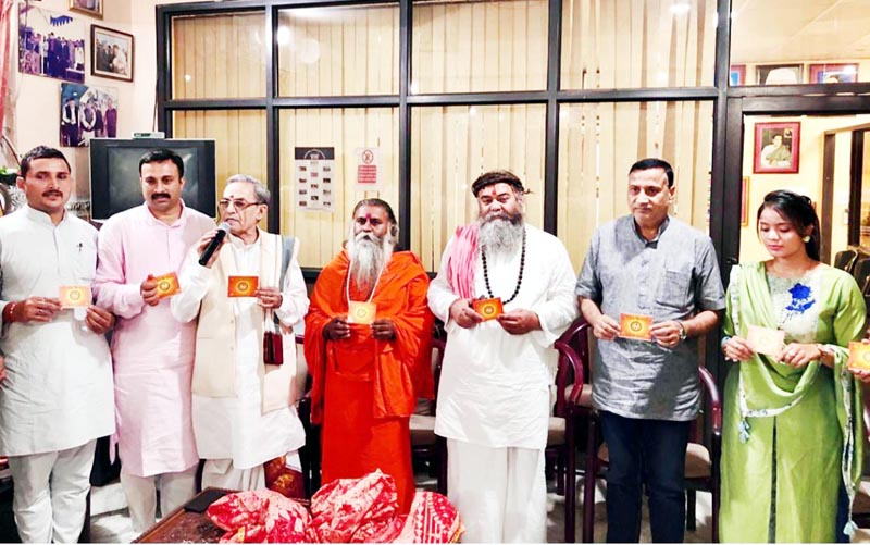 Former Minister Sham Lal Sharma along with other dignitaries releasing 'Shri Kailakh Dev Chalisa' at a function in Jammu.