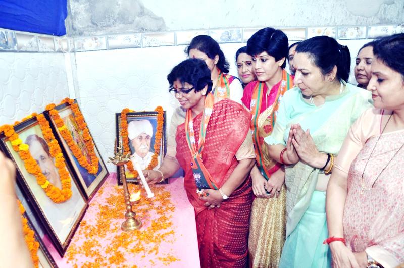 BJP Mahila Morcha, national president, Vijay Rahatkar lighting the lamp during a party programme at Akhnoor on Monday.