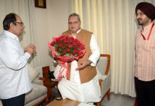 President of Ludhiana based foundation Balbir Kumar briefing Governor Satya Pal Malik about child heart surgery project.