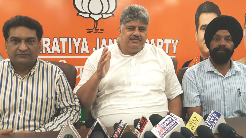 BJP, Vice President Narayan Singh & party spokesman Balbir Ram Rattan talking to reporters at Jammu on Thursday.