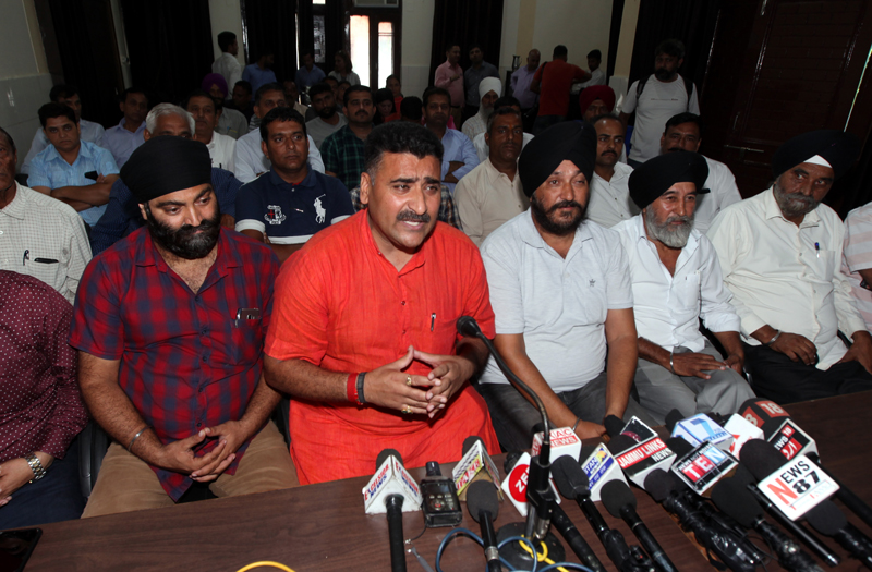 Anil Sharma, AJKPC State president addressing media persons at Jammu. -Excelsior/Rakesh