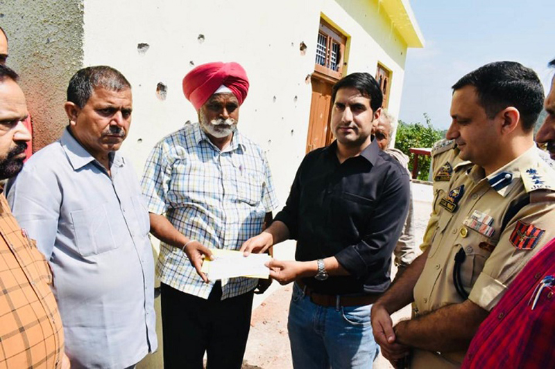 DDC Rajouri giving cash relief to shelling affected victim.
