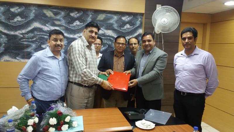 Chairman J&K Grameen Bank, Janak Raj Angural and officials of Bajaj Allianz during a meeting in Jammu on Thursday.
