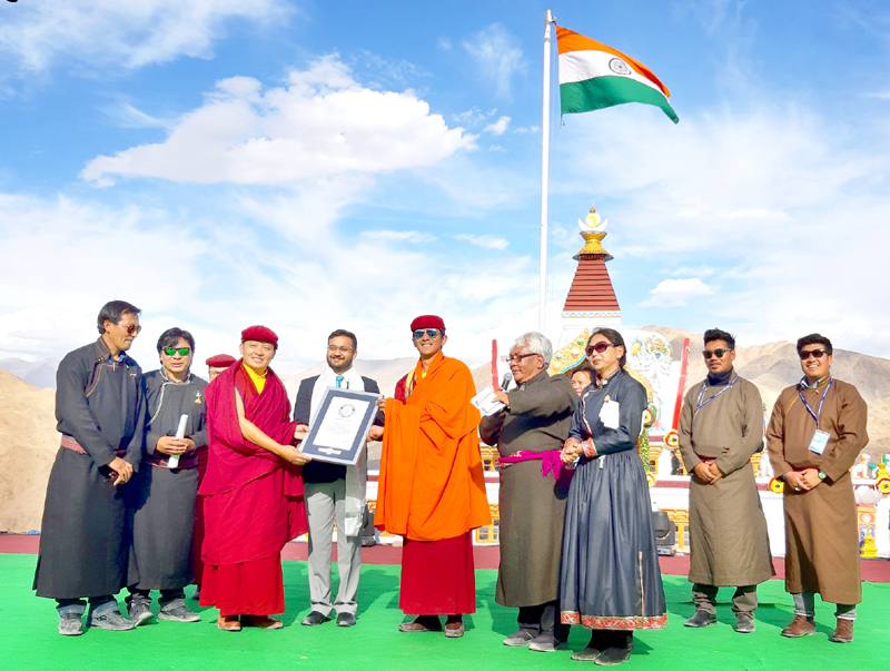 Guinness World Records official adjudicate, Swapnil Dangarikar presenting the record certificate to Chairman, Naropa Festival Organizing Committee, Drukpa Thuksey Rinpoche. -Excelsior/Morup Stanzin
