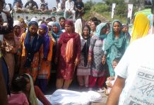 Family members and relatives of deceased PHE worker protesting at Tikri on Wednesday.