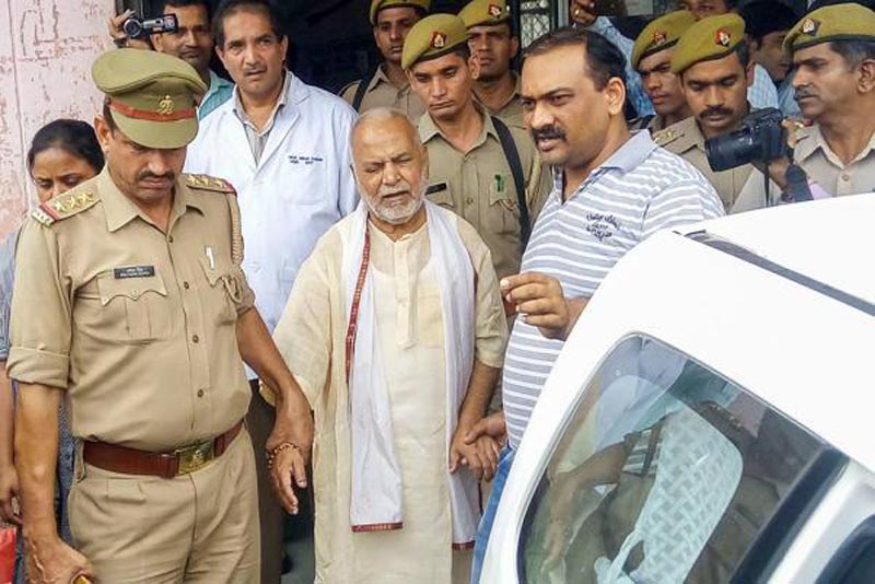 Former Union Minister Swami Chinmayanand, accused of rape by a law student, is seen outside a Government hospital after a medical examination following his arrest by a special team of Uttar Pradesh police, in Shahjahanpur.