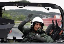 Defence Minister Rajnath Singh waving during a familiarization sortie in LCA TEJAS from HAL airport, in Bengaluru on Thursday. (UNI)