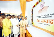 Uttar Pradesh Chief Minister Yogi Aditiyanath with BJP state president Swatantra Dev Singh inaugurating an exhibition based on the life and achievements of Prime Minister Narendra Modi at party office in Lucknow on Monday. (UNI)