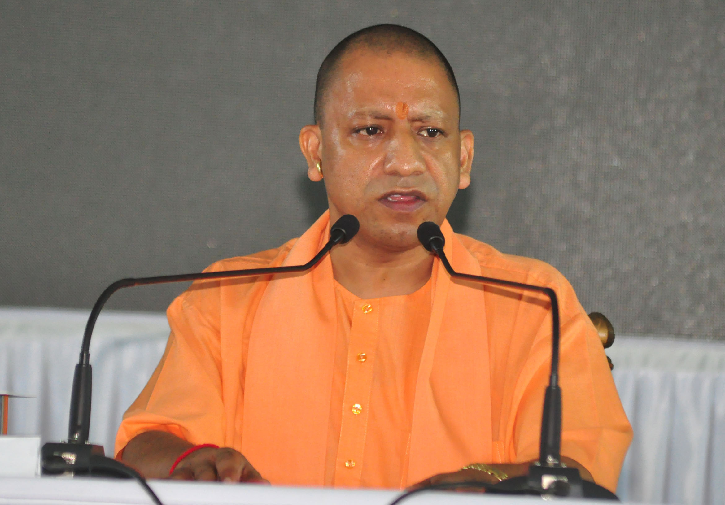 Uttar Pradesh Chief Minister Yogi Adityanath addressing press conference on completing 30th months in his office, at CM residence in Lucknow on Thursday. (UNI)