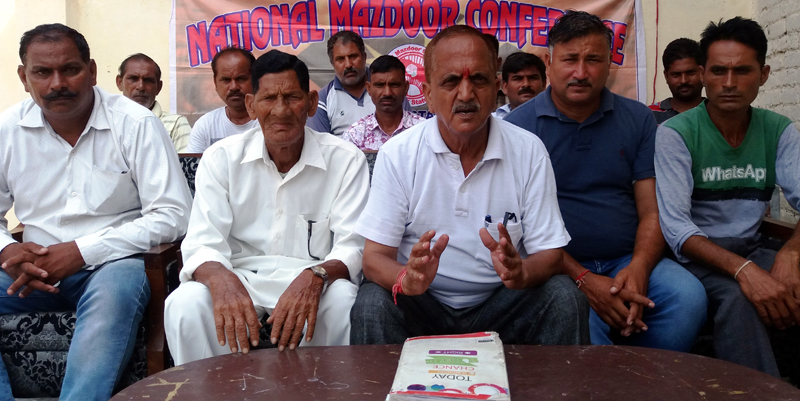 Subash Shastri addressing a gathering of NMC workers at Jammu on Monday.