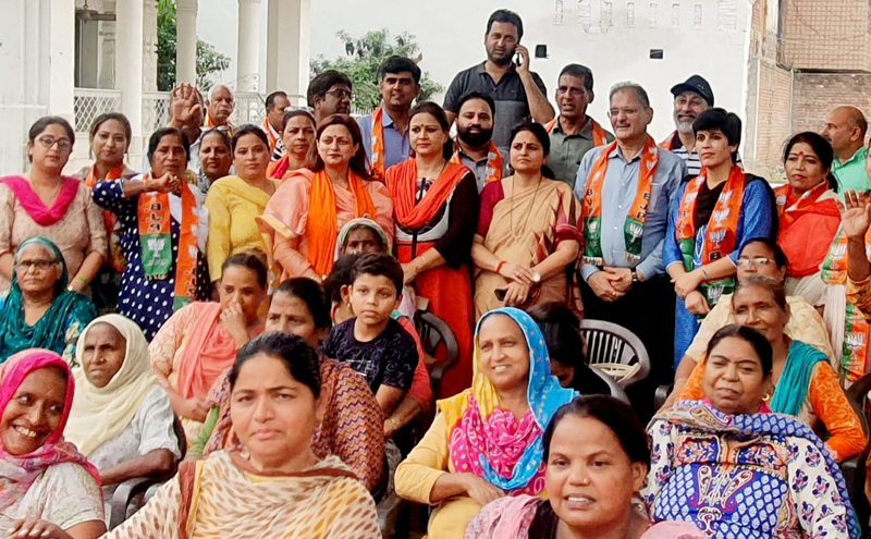 BJP Mahila Morcha activists along with former Deputy CM, Kavinder Gupta at Jammu on Friday.