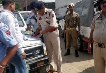 SSP Traffic Mohan Lal Kaith challaning a vehicle on Tuesday.