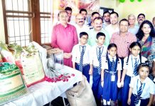 Former Deputy CM, Kavinder Gupta & MLC, Vikram Randhawa distributing food items to the SOS Home Children at Jammu on Friday.