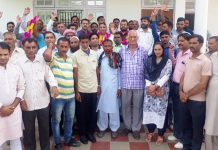 Deputation of people of Nowshera posing with BJP team led by Sat Sharma on Monday.