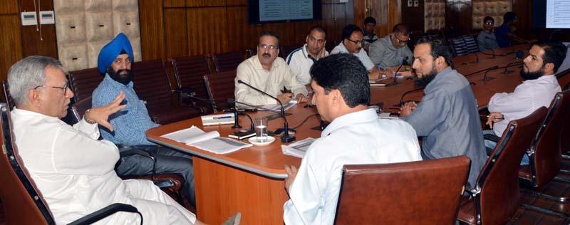 Advisor Farooq Khan chairing a meeting on Thursday.