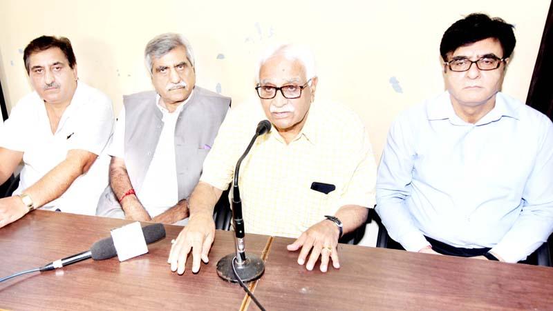 Former CS and chief patron Vyeth, Vijay Bakaya, former DGP, Kuldeep Khuda with Prof. B.L Zutshi and Prof Virender Rawal talking to reporters at Jammu on Sunday.