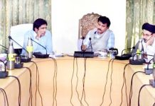 CEC Kargil chairing a meeting on Friday.