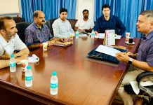 Amit Sharma chairing a meeting at Jammu on Saturday.