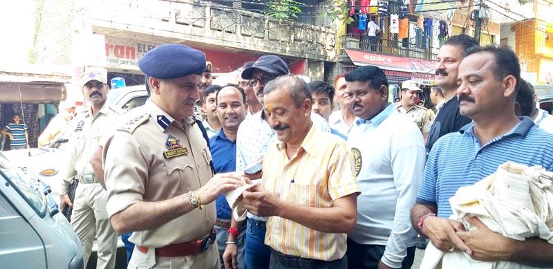 SSP Samba Shakti Pathak distributing jute bags among people at Samba on Saturday.