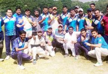 Teams posing for a group photograph after playing a friendly cricket match in Jammu.