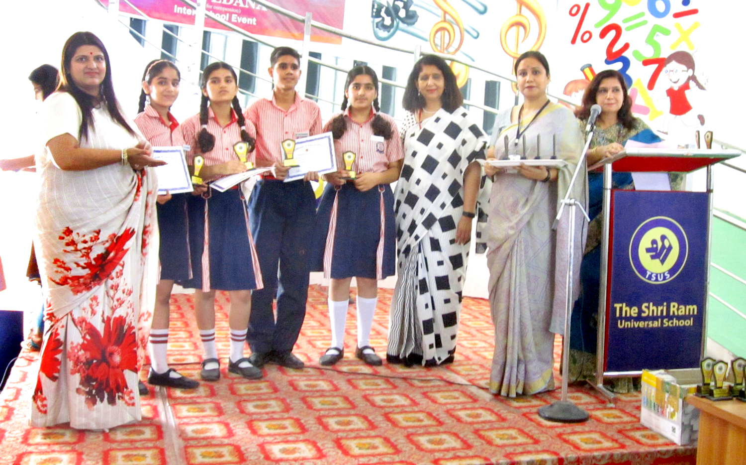 Winners of Shri Samvedana displaying certificates while posing along with dignitaries in Jammu on Thursday.