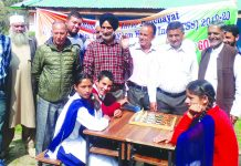 Chief guest and other officials observing players during Carrom Tournament in Udhampur on Thursday.