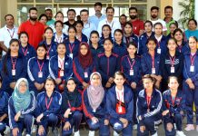 Participants posing for a group photograph along with dignitaries and officials during inaugural ceremony of Martial Art Workshop at SMVDSB.