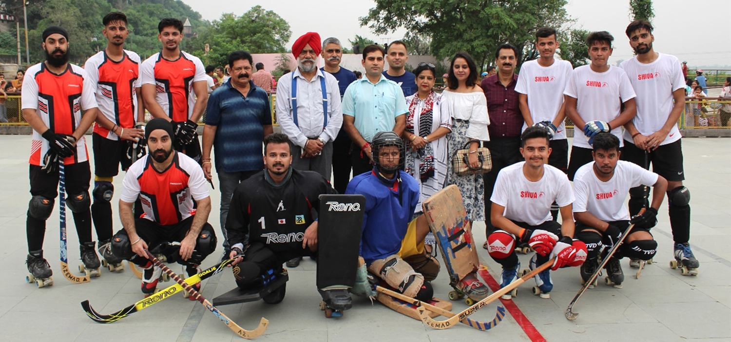 Skaters posing along with GS Khurmi and Narotam Sharma during the concluding function of State Roller Skating Championship at Shiva Roller Skating Institute Peer-Kho in Jammu.