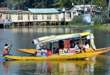 Tourists enjoy 'Shikara' ride in Dal lake. — Excelsior/Shakeel