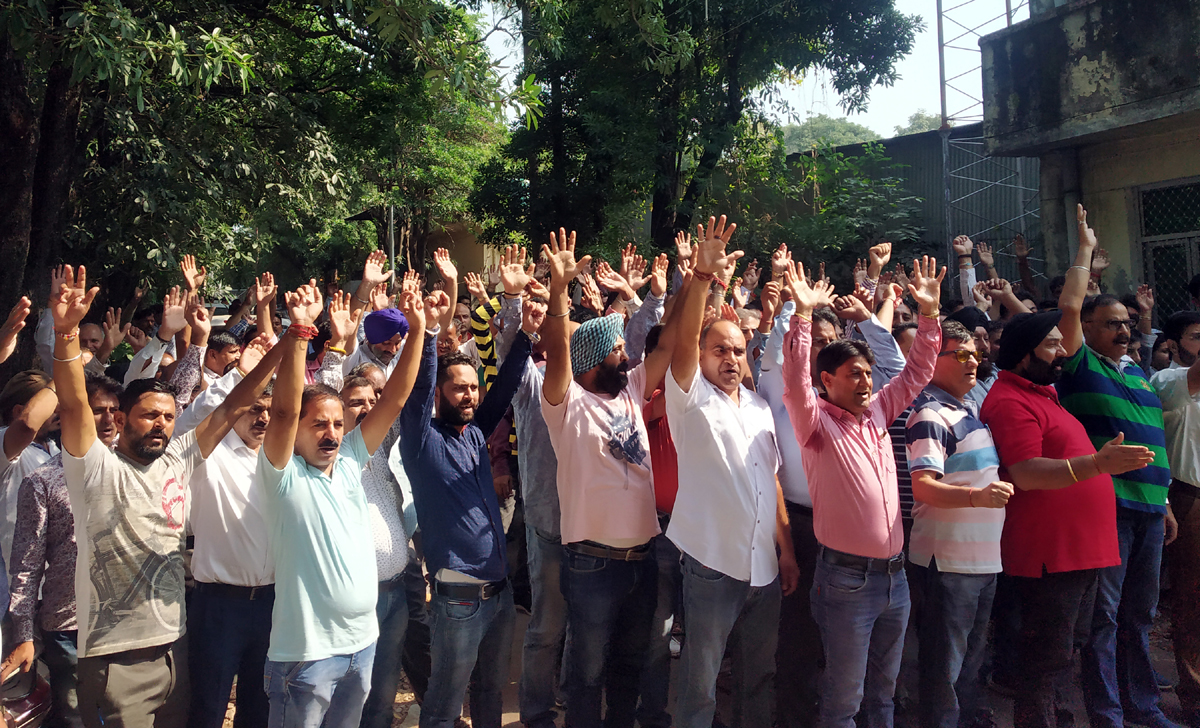 PDD employees protesting in Jammu on Sunday.