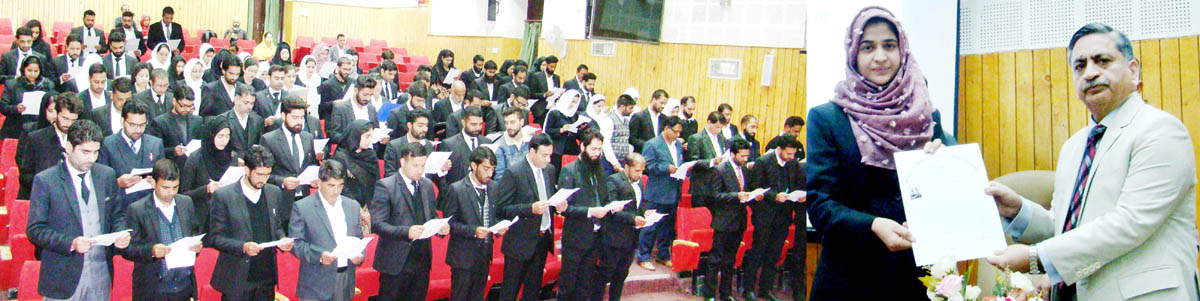 Justice Sanjeev Kumar administering oath to newly enrolled advocates.