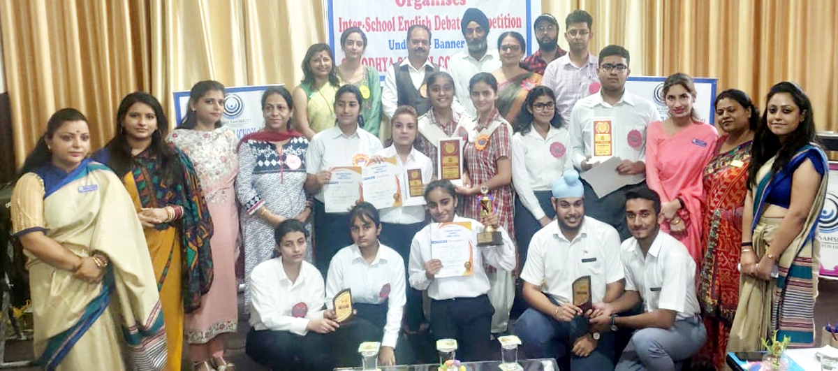 Winners of Debate competition posing along with dignitaries and officials at Jammu Sanskriti School, Jammu.