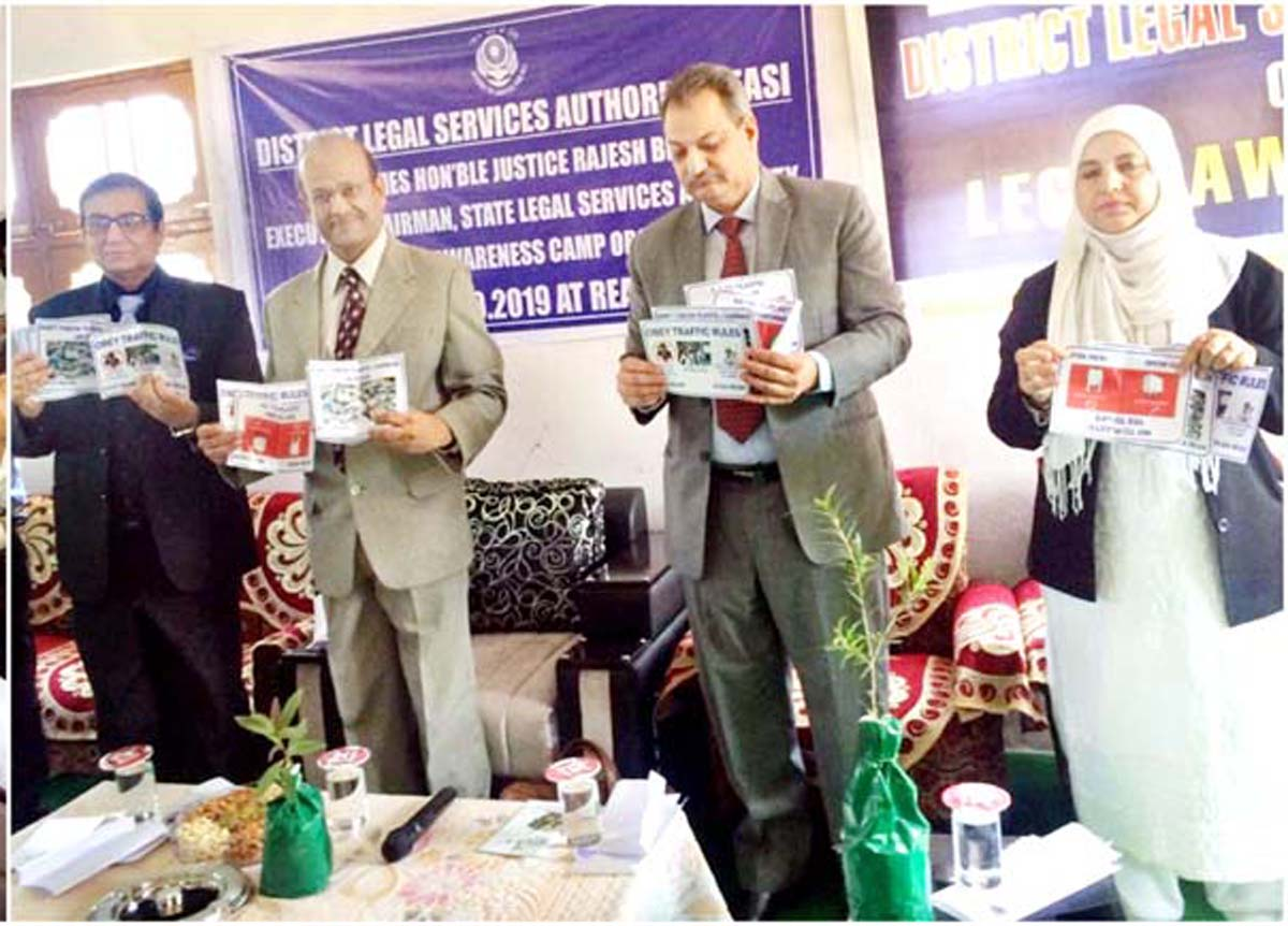 Justice Rajesh Bindal, Executive Chairman, J&K SLSA and other dignitaries releasing pamphlets on environmental issues.