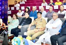 Advisor Farooq Khan witnessing performance of a participant during 'Jammu Ki Awaaz'.