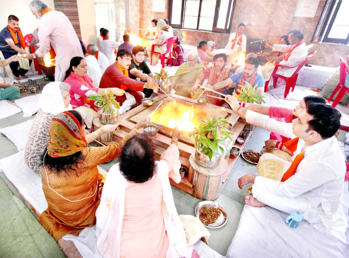 Devotees participating in Purnaahuti of Samved Yagya at Arya Samaj Temple, Bakshi Nagar in Jammu.