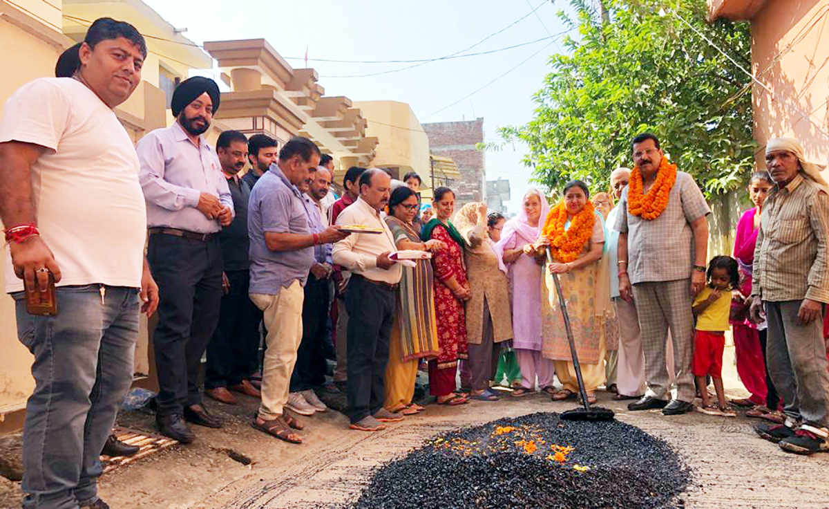 Corporator of Ward No 42, Vijay Choudhary kick starting black topping work in Sector 5 of Nanak Nagar, Jammu.