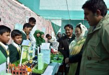 Deputy Commissioner Kargil, Baseer-ul-Haq Choudhary inspecting model during Science Festival.
