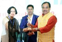 Deepika K Sharma, Director Tourism, Jammu receiving 'Best Award for Promotion of Golf Tourism' from Minister Dr Harak Singh Rawat.