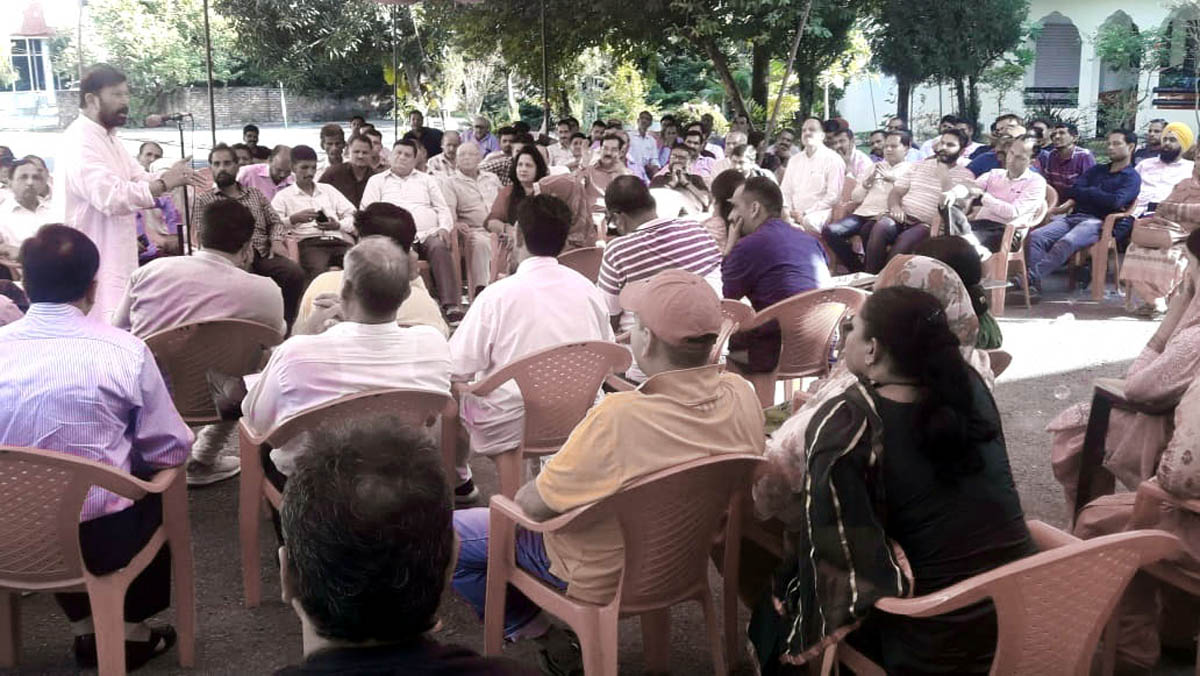 Ch Lal Singh addressing Panchayat members and DSSP activists at his residence in Kathua on Saturday.