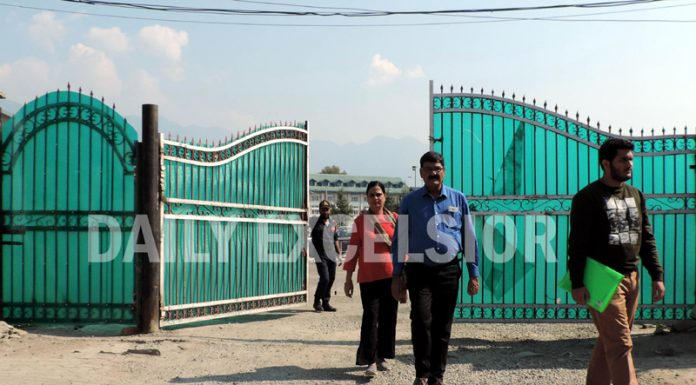 A student enters NIT in Srinagar on Tuesday. -Excelsior/Shakeel